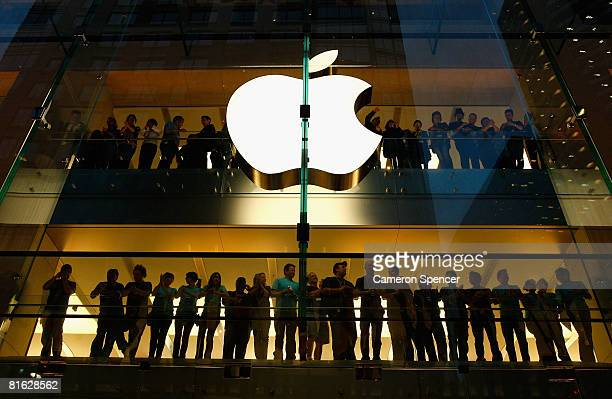Apple staff wait for the offical opening of the new Sydney Apple Store on June 19 2008 in Sydney Australia The new $AUD 15 million store is the 215th...
