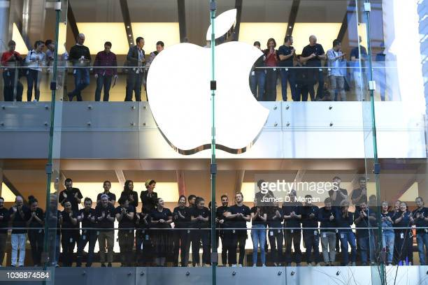 Apple staff watch the first customers in line at the Australian release of the latest iPhone models at the Apple Store on September 21 2018 in Sydney...