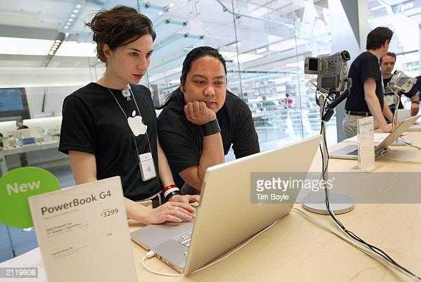 Apple store employees Sara Champagne and Ermin Mistica set up new Apple computers and related peripherals in the new Apple computer retail store on...