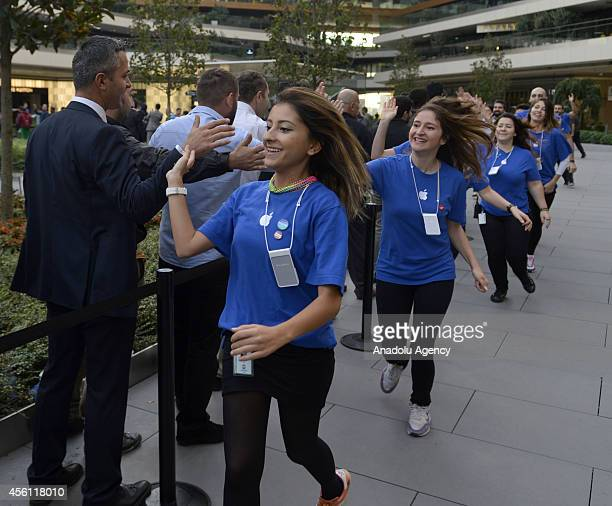 Apple Store workers deal with customers who waiting outside Zorlu Center as iPhone 6 and iPhone 6 Plus retail sales begin at Apple Store in Zorlu...