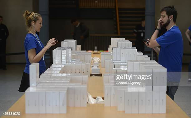 Apple store workers stands next to new products of Apple iPhone 6 and iPhone 6 Plus at an Apple Store in Madrid Spain on September 26 2014 The iPhone...