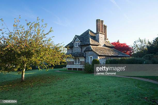 Apple Tree and Cottage at Blaise Hamlet. Bristol. England the nearby Blaise hamlet in the Blaise Castle Estate is a small hamlet of storybook appearance with beautiful thatched roofs and Jacobean chimneys.