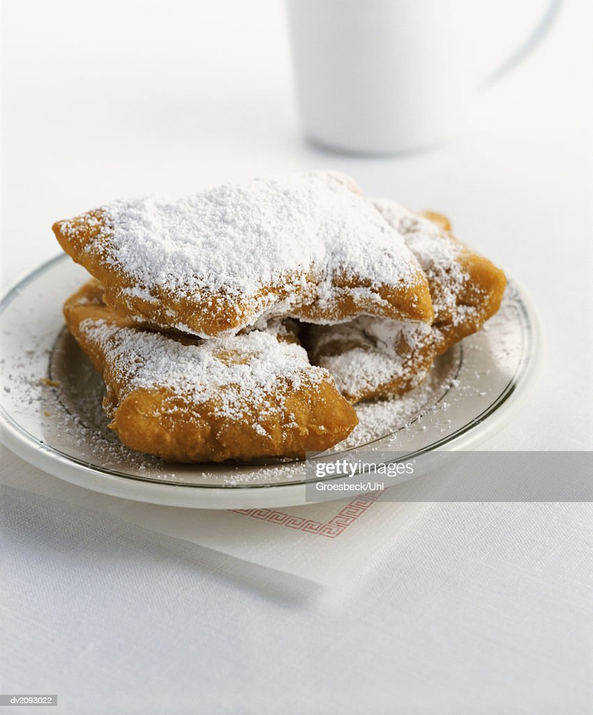 Apple Turnovers Covered in Icing Sugar on a Saucer : Stock Photo