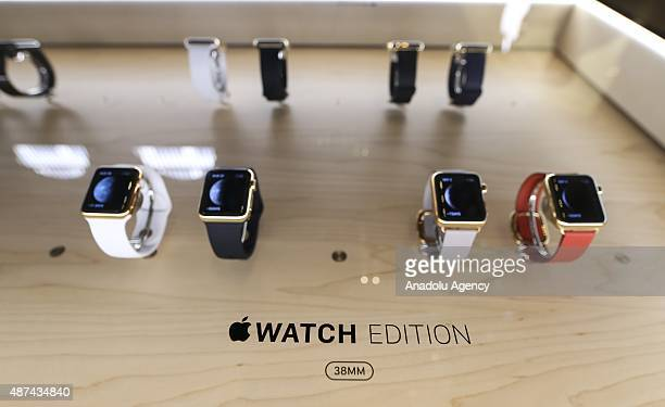 Apple watches are displayed as people watch Apple's announcement of new versions of old products at a Apple Store in New York NY on September 9 2015...