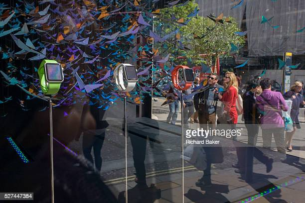 Apple Watches are displayed in a corner window of department store Selfridges in Oxford Street Apple has taken over a corner window display at the...