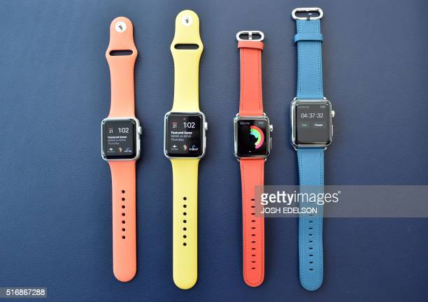 Apple watches with new band colors are seen on display during a media event at Apple headquarters in Cupertino California on March 21 2016 / AFP /...