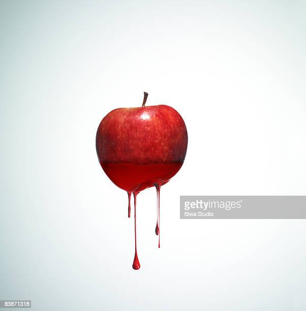 Apple with drippy red ink