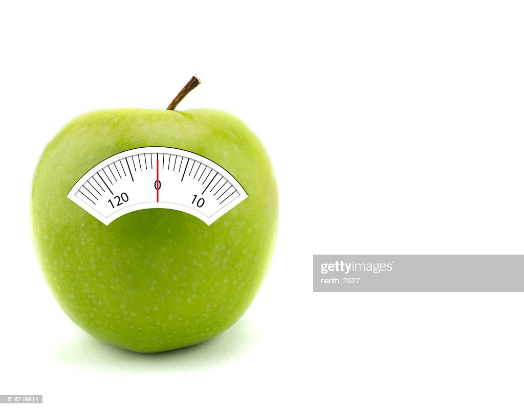 Apple with scales weight, isolated on white background : Stock Photo