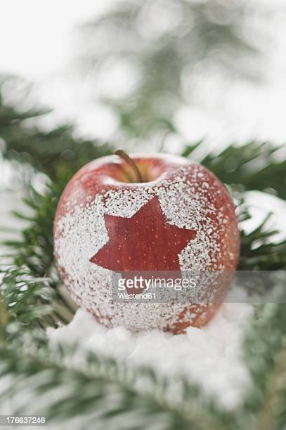 Apple with snow star, close up