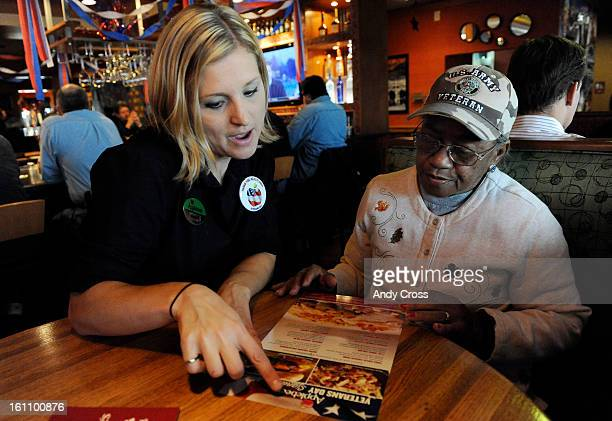 GLENDALE CONOVEMBER 11TH 2010 Applebee's restaurant waitress Nicole Thomason left points out the menu to US Army Veteran Nurse Dolores Collins for a...