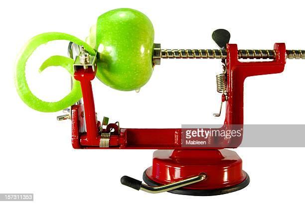appler peeler with a green apple - dunschiller stockfoto's en -beelden