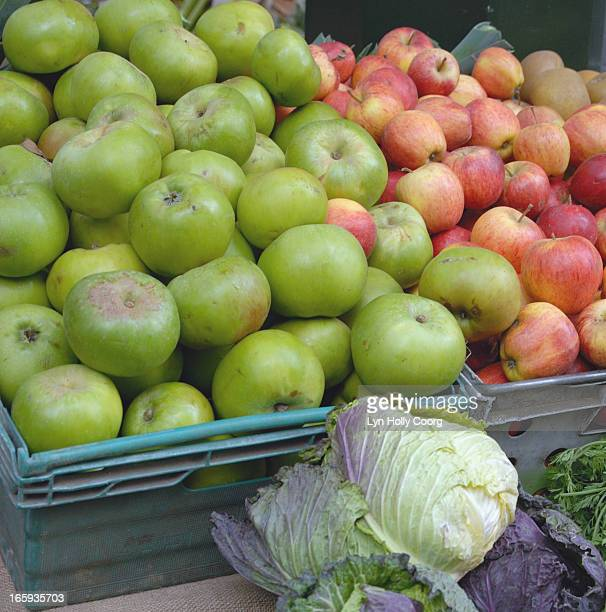 apples and cabbages in market place - lyn holly coorg stock photos and pictures