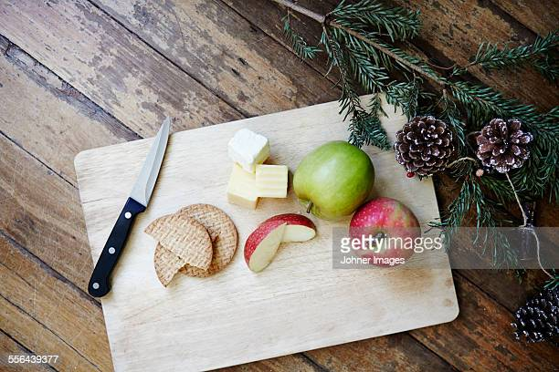 Apples and cheese on chopping board