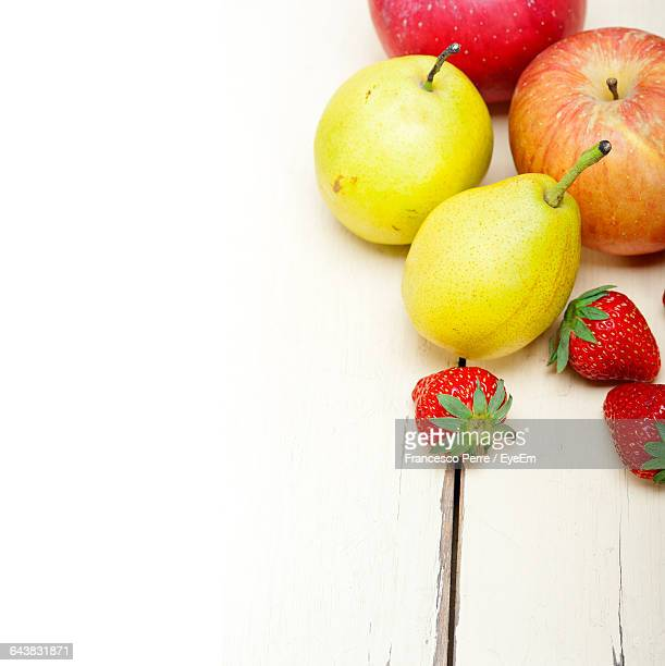 Apples And Pears With Strawberries On Table