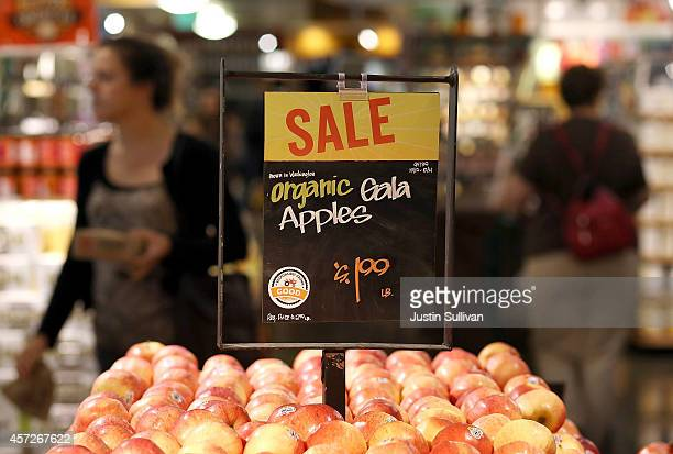Apples are displayed with a 'good' rating at a Whole Foods market on October 15 2014 in San Francisco California Upscale grocery chain Whole Foods...
