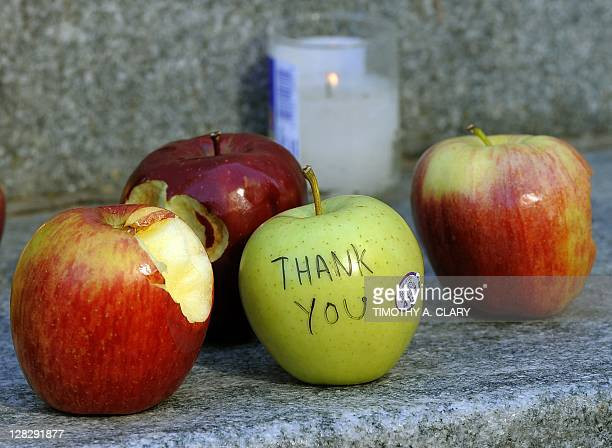 Apples are left outside the Apple Flagship store on 5th Avenue in New York October 6 2011 the morning after the death of former Apple CEO and...
