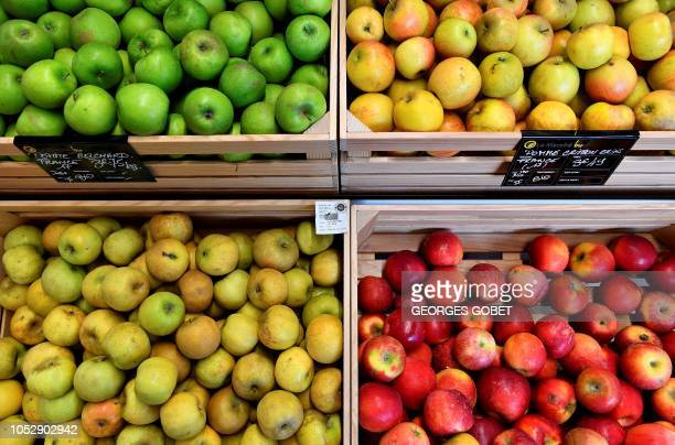 Apples are on sale in an organic supermarket in Saintes western France on October 23 2018 According to the public information platform Agence Bio...