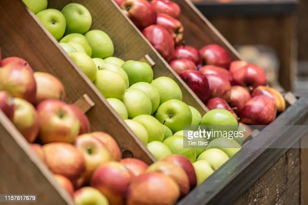 apples for sale in wooden box. - large group of objects stock pictures, royalty-free photos & images