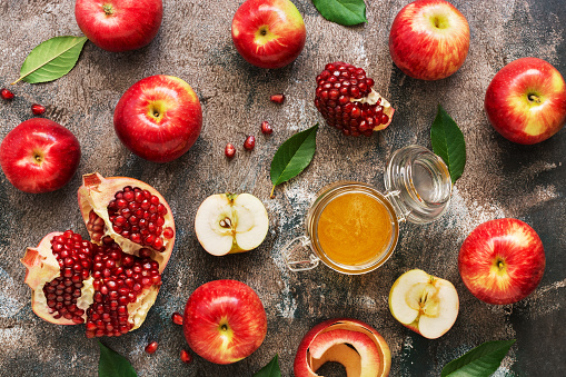 Apples, honey and pomegranate on a rustic background. Jewish New Year holiday. Top view, overhead, flat lay. 1026666382