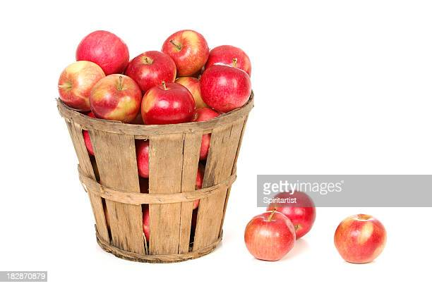 apples in a farm basket on white - basket stock photos and pictures