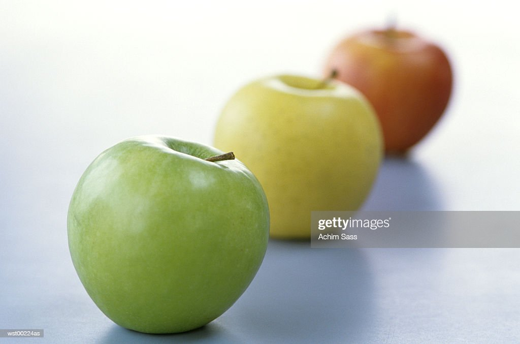 Apples in a line, close up : Stock Photo
