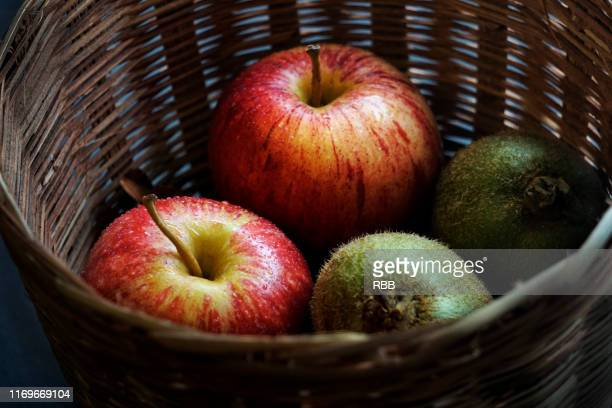 apples in basket - inbox filing tray stock pictures, royalty-free photos & images