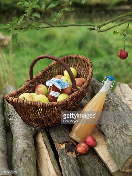 Apples in basket with jar and juice