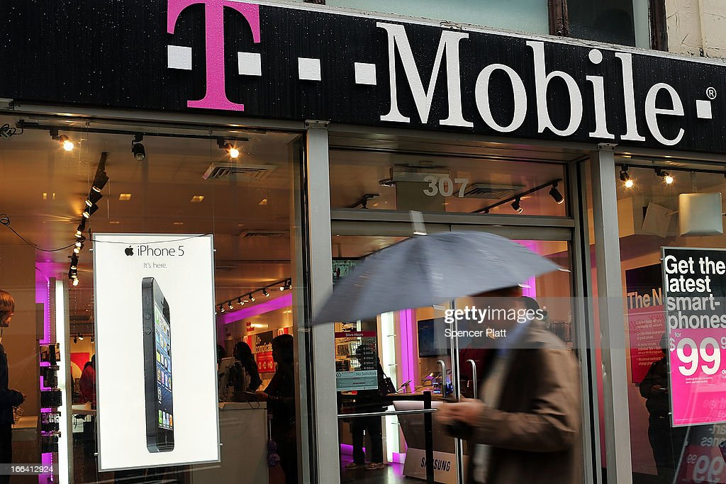 Apple's iPhone 5 is advertised in the window of a Manhattan T-Mobile store on April 12, 2013 in New York City. Following years of waiting to sell the phone, T-Mobile will begin supporting and selling the iPhone 5 on its network starting on Friday.