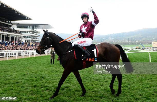 Apple's Jade ridden by Bryan Cooper celebrates after winning the OLBG Mares Hurdle during Champion Day of the Cheltenham Festival at Cheltenham...