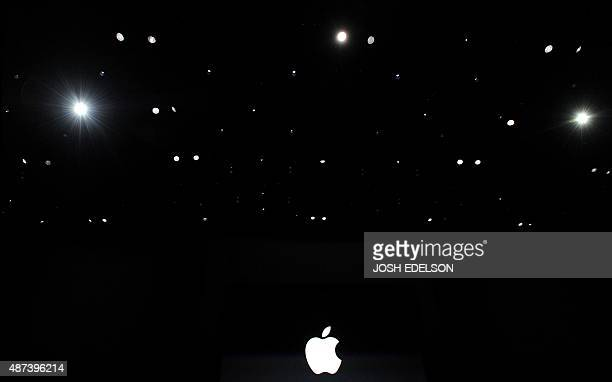 Apple's logo is seen among stage lights before the start of a media event in San Francisco California on September 09 2015 Apple on Wednesday...