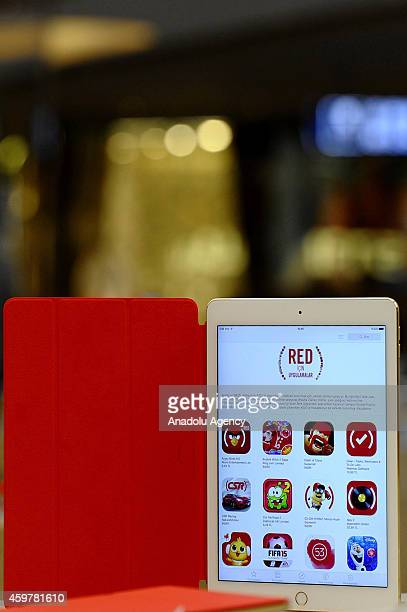 Apple's new campaign called RED is seen on the screen of an iPhone in Istanbul Turkey on December 1 2014 Apple will be hosting a special section on...