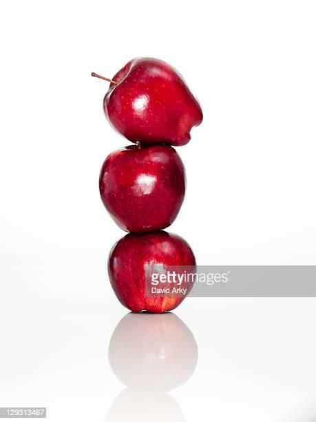 Apples on top of each other on digital tablet, studio shot