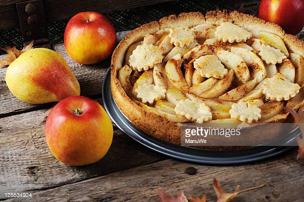 Apples, Pears and Pear cake on a wooden board
