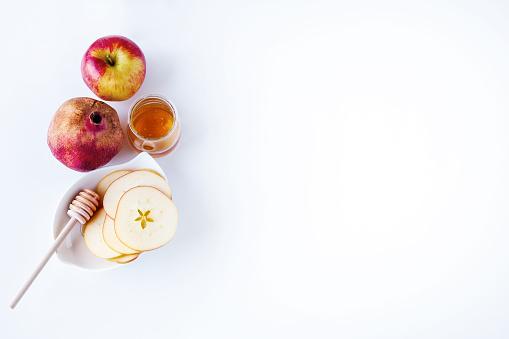 Apples, pomegranate and honey for Rosh Hashanah 592364112