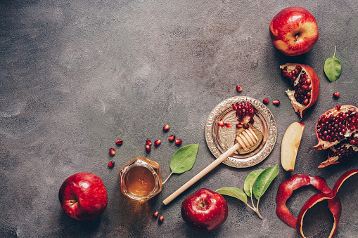 Apples, pomegranate and honey on a dark rustic background. Traditional Jewish food. New Year - Rosh Hashanah. Top view, copy space, flat lay. 1158250073