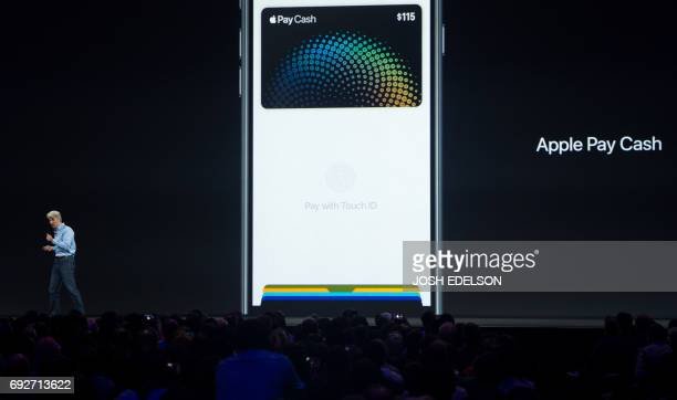 Apple's Senior Vice President of Software Engineering Craig Federighi speaks about Apple Pay on stage during Apple's World Wide Developers Conference...