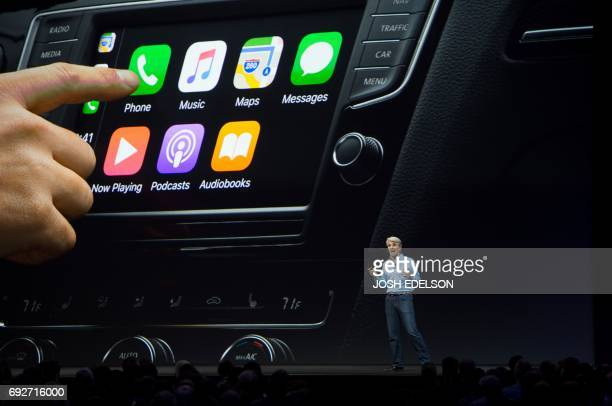 Apple's Senior Vice President of Software Engineering Craig Federighi speaks about CarPlay on stage during Apple's World Wide Developers Conference...