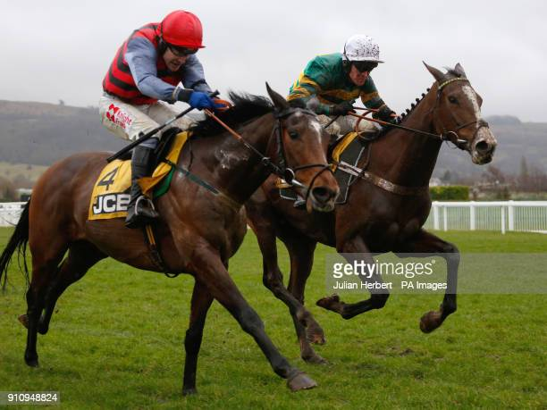 Apple's Shakira and Barry Geraghty get the better of Look My Way and Tom Scudamore to win The JCB Triumph Trial Juvenile Hurdle Race run during...