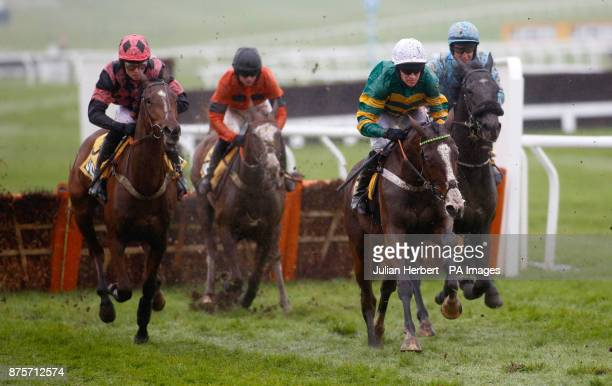 Apple's Shakira and Barry Geraghty pull away from an early flight to go on and win The JCB Triumph Trial Juvenile Hurdle Race run during day two of...