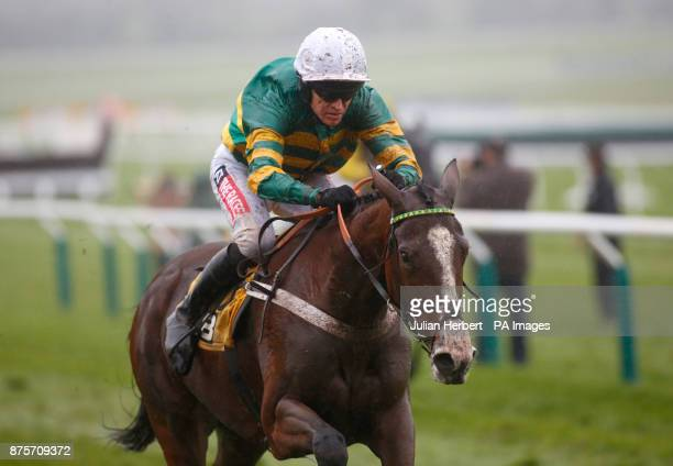 Apple's Shakira and Barry Geraghty pull away from the last flight to go on and win The JCB Triumph Trial Juvenile Hurdle Race run during day two of...