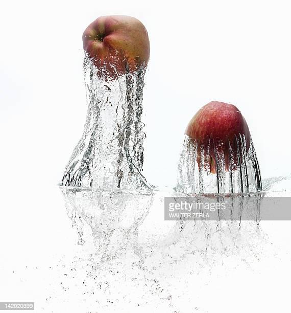 Apples splashing in water