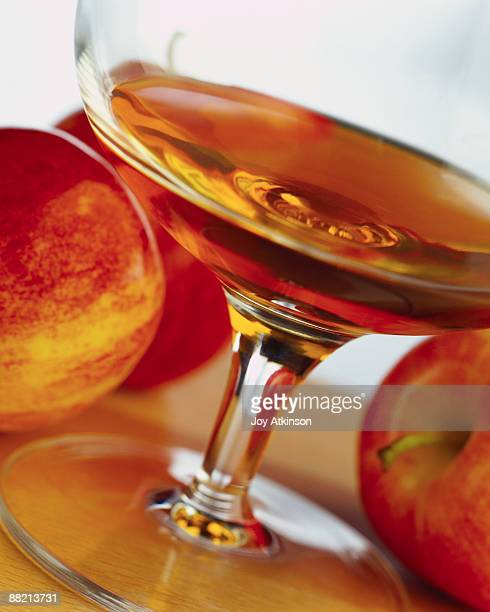 apples with glass of calvados - カルヴァドス県 ストックフォトと画像