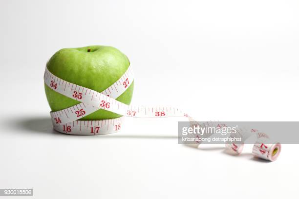 Apples with measuring tape.