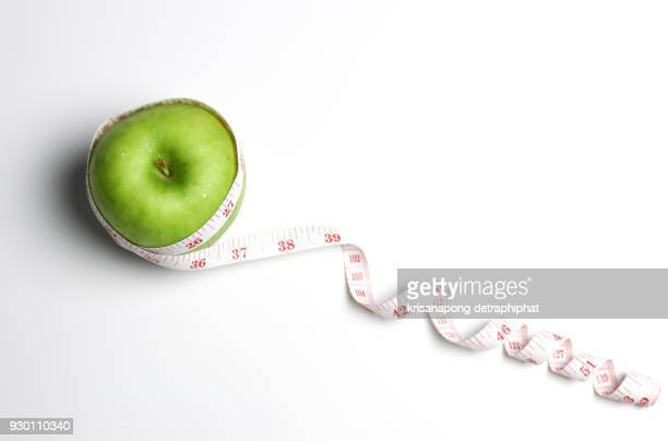 apples with measuring tape. - centimetre stock photos and pictures