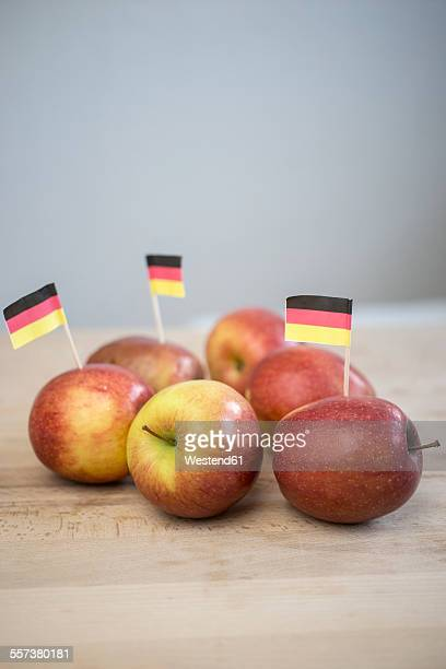 Apples with small little german flag on wood