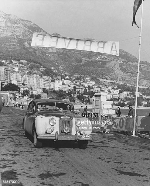 EI Appleyard and PC Appleyard arrive at the MonteCarlo Beach in their Jaguar during the MonteCarlo Rally