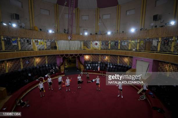 Applicants juggle prior to perform in front of the jury for their admission exam at the circus college in Moscow, on July 5, 2021. - The State...
