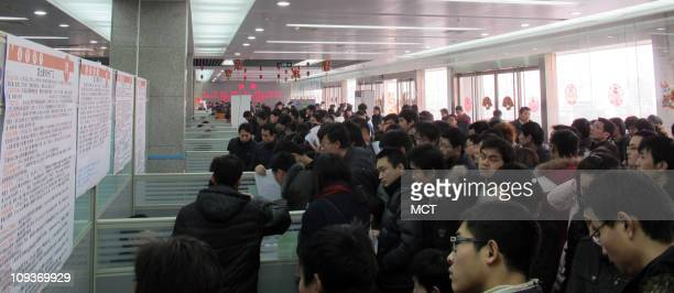 Applicants line up at a Foxconn recruitment booth in Zhengzhou, China, February 17, 2011.