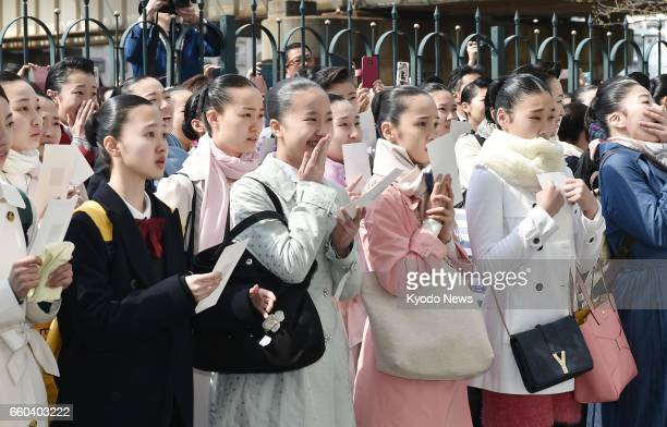 Applicants look for their numbers on a board to see if they have passed tests to enter the Takarazuka Music School the institution to train young...