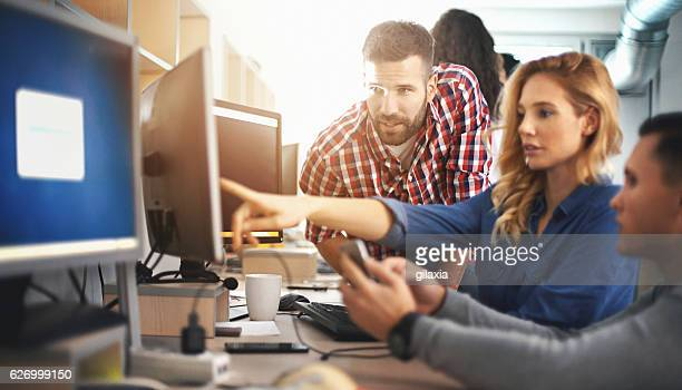 application developers at work. - solutions stock pictures, royalty-free photos & images